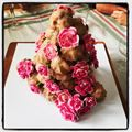 Croquembouche with pink flowers